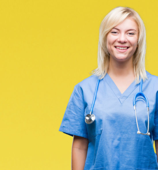 Young beautiful blonde doctor woman wearing medical uniform over isolated background with a happy and cool smile on face. Lucky person.